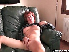Redheaded grown-up mom plays with will not hear of nipples and pussy