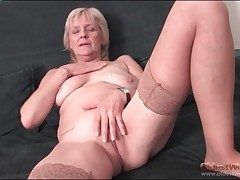 Granny strips to stockings together with fingers pussy