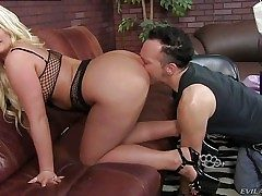 Julie Cash is a curvaceous blond domina with huge jugs