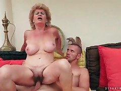 Puckered granny with gigantic tits rails her guy
