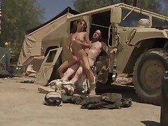 Soldier in uniform is penetrating a damsel