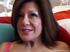 Magnificent mature dame plays with her humid pussy