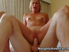 Low-spirited Suz is a slutty milf who takes hard young